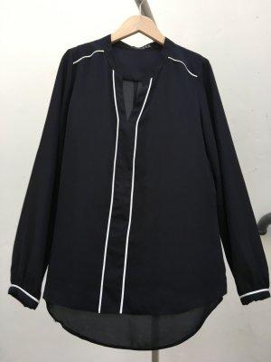 Modische Bluse schwarz mit weißen Highlights
