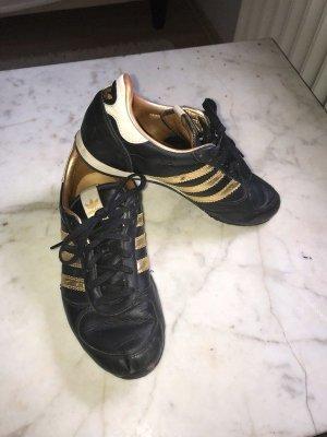 Adidas Originals Sneaker stringata nero-oro