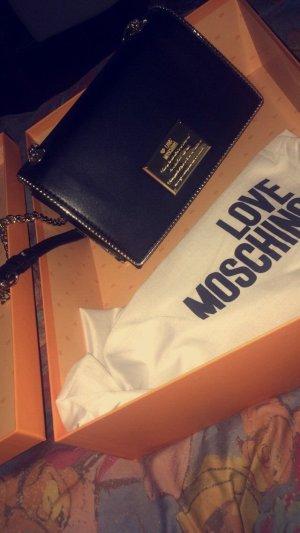Moschino Tasche- schwarze Tasche mit goldener Platte