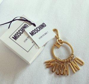 Moschino Taschenanhänger Gold Buchstaben Letter