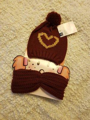 Mütze und Schal in den Winter