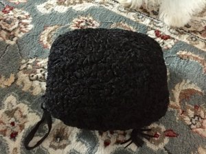 Muff aus Lammfell mit Tasche / statt Handschuhe / Schwarz