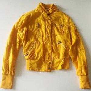 Windjack goud Oranje-wit Textielvezel