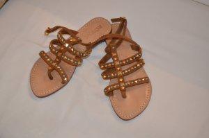 Sandalias de tacón con barra en T color bronce Gamuza