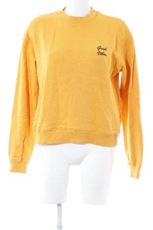 NA-KD Sweatshirt orange-schwarz Schriftzug gestickt Casual-Look