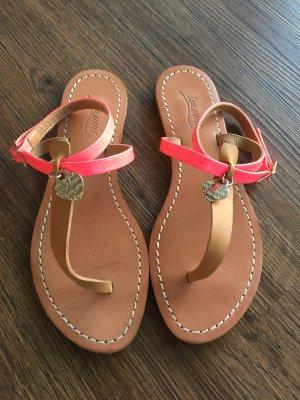 Sandalias de tiras rosa neón Cuero