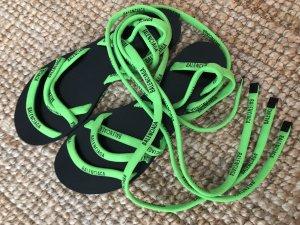 Neongrüne Sandalen zum Schnüren