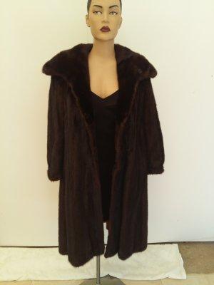 Manteau de fourrure brun foncé pelage
