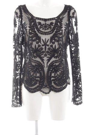 Top maillé noir motif abstrait élégant