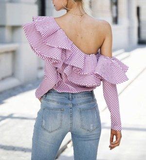 Blusa con volantes blanco-rosa