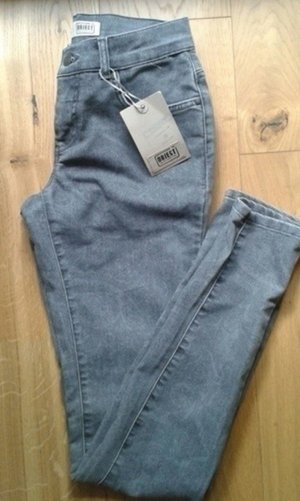 Neue graue Jeans mit Paisley Muster
