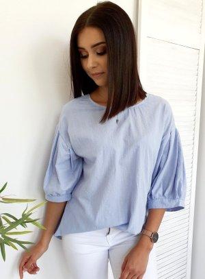 Blusa ancha azul claro