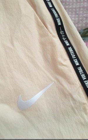 Nike Sportbroek room-abrikoos