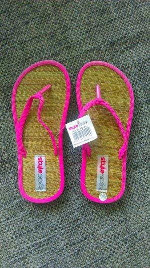 Neue pinke Flip Flops