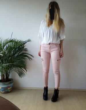 neue rosafarbene Jeans / Röhrenjeans mit Reißverschlüssen