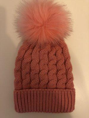 Sombrero de punto rosa neón