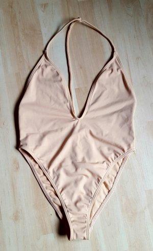 neuer nude farbender Badeanzug mit tiefem Ausschnitt