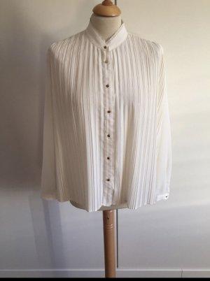 Neuwertige cremefarbene Bluse mit Plisee
