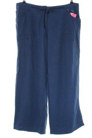 Next Pantalón de lino azul look casual