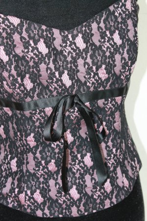 Nicowa Corsage zwart-roze