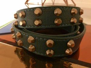 Cinturón de pinchos color oro-petróleo