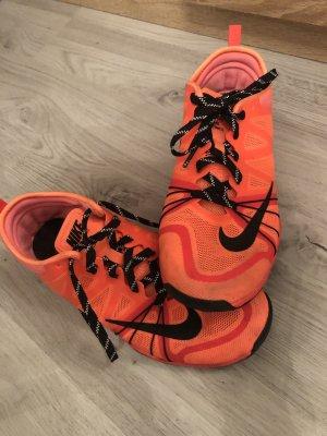 Nike Sneaker stringata nero-arancio neon