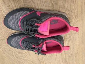 Nike Basket à lacet gris-rose
