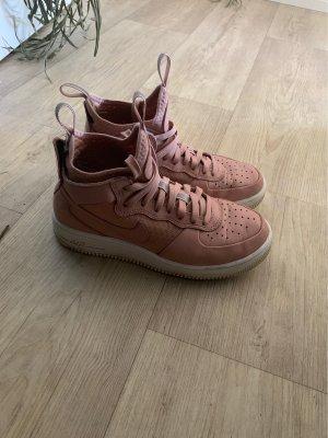 Nike Sneaker stringata color oro rosa