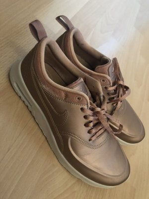 Nike Basket à lacet or rose