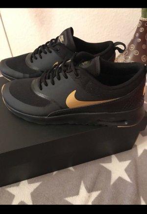 Nike Basket noir-doré
