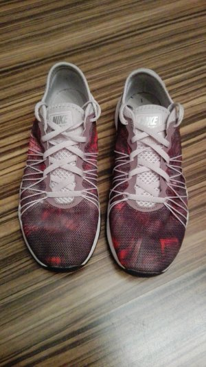 Nike dual fusion in rosé-rot