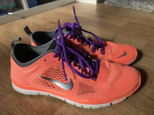 Nike Sneaker slip-on arancio neon-lilla