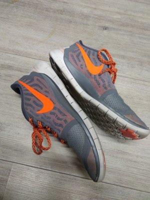 Nike free 5.0 grau orange Gr. 38,5