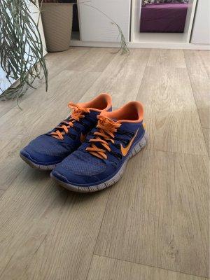 Nike Sneaker stringata arancio neon-blu fiordaliso