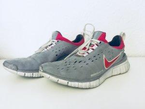 Nike Sneaker stringata grigio-rosso lampone
