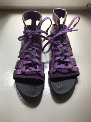 Nike Sandalias romanas negro-lila