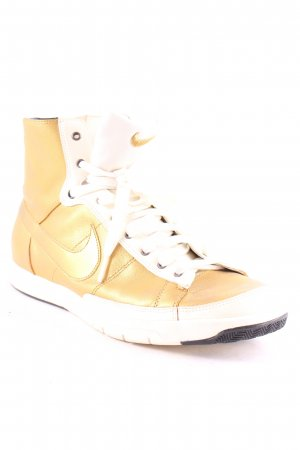 Nike High Top Sneaker goldfarben-weiß abstrakter Druck Casual-Look