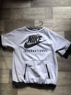 Nike international  Oversize Shirt mit Reißverschluss Taschen