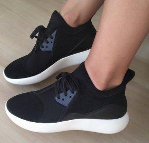 Nike Basket slip-on blanc-noir