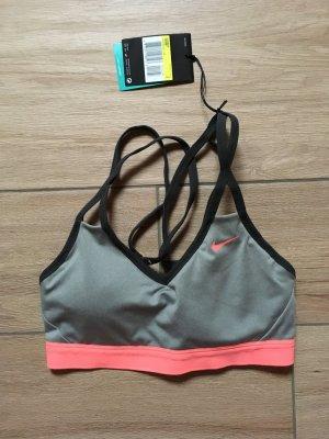 Nike Pro Indy Strappy Bra Sport-BH Größe S grau rosa