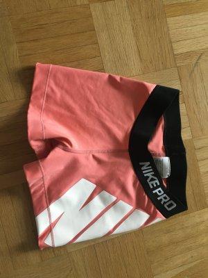 Nike pro Shorts lachsfarben mit weißem Logoprint, XS