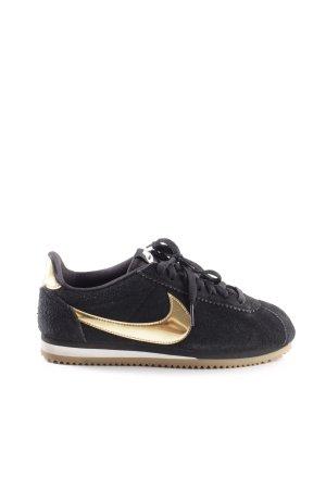 Nike Schnürsneaker schwarz-goldfarben sportlicher Stil