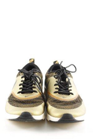 Nike Schnürsneaker schwarz-goldfarben Casual-Look