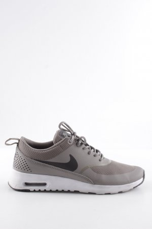 Nike Schnürsneaker hellgrau-schwarz Motivdruck Casual-Look