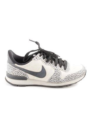 Nike Schnürsneaker schwarz-weiß Punktemuster sportlicher Stil