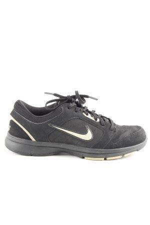 Nike Schnürsneaker schwarz-goldfarben Motivdruck schlichter Stil