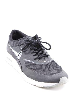 Nike Schnürsneaker schwarz-weiß Motivdruck sportlicher Stil