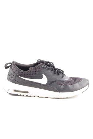 Nike Schnürsneaker schwarz-weiß platzierter Druck sportlicher Stil