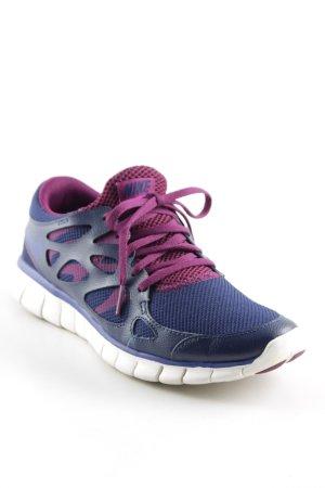 Nike Schnürsneaker violett-dunkelblau sportlicher Stil
