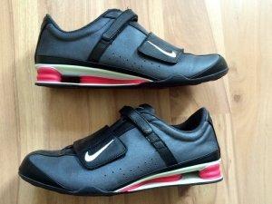 Nike Sneaker con strappi nero-magenta